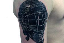 Hockey helmet tattoo on the arm
