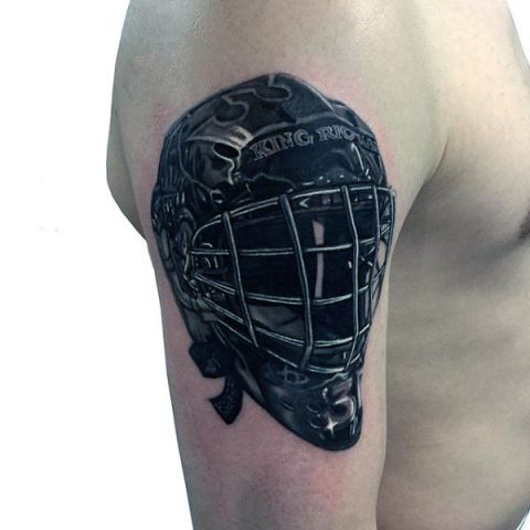 Hockey helmet tattoo on the arm