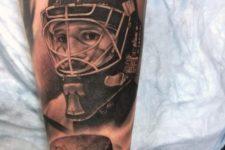 Hockey player and hockey puck tattoo