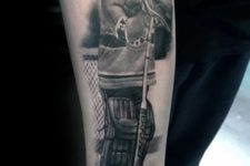 Hockey player tattoo on the arm