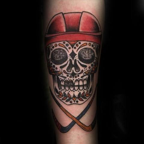 Hockey themed tattoo with a skull