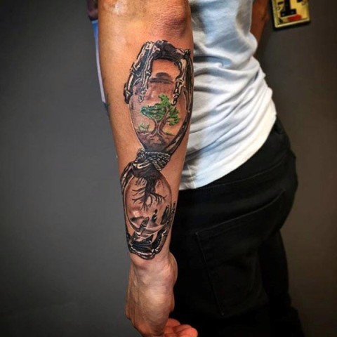 Hourglass with tree of life tattoo on the hand