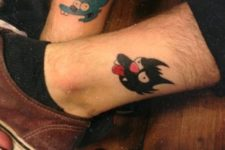Itchy and Scratchy tattoos on the legs
