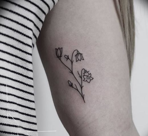 Minimalistic tattoo design on the arm