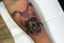 Skull and golf clubs tattoo