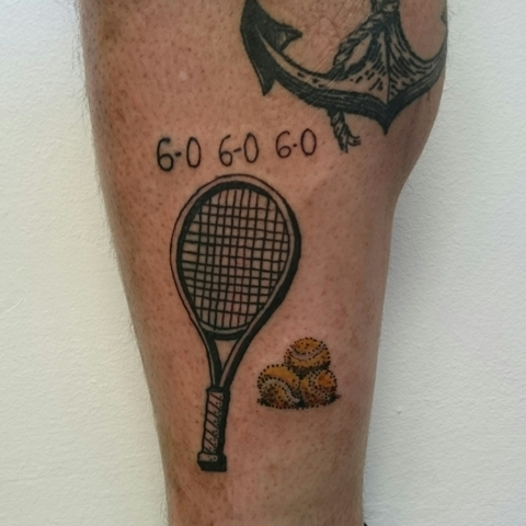 Small tennis racket tattoo