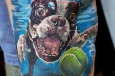 Tennis ball and dog tattoo on the leg