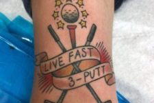Two golf clubs and ball tattoo