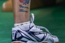 Two rackets tattoo on the ankle