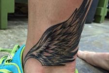 Wing tattoo on the ankle