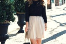 With airy skirt, black shoes and small bag