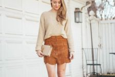 With beige sweater, leather clutch and pumps