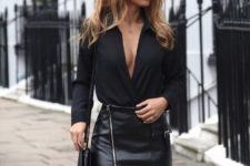 With black V-neck blouse and black leather small bag