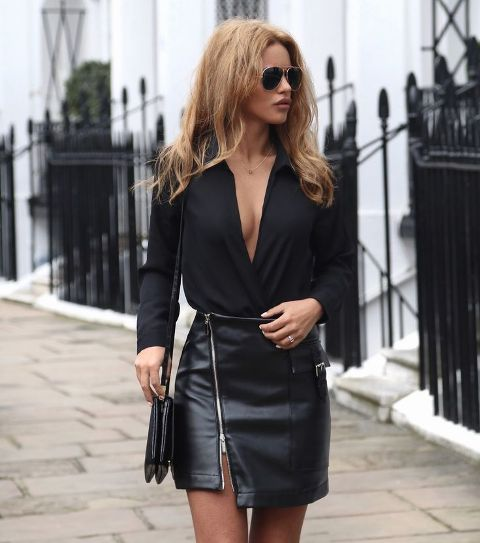 With black V neck blouse and black leather small bag