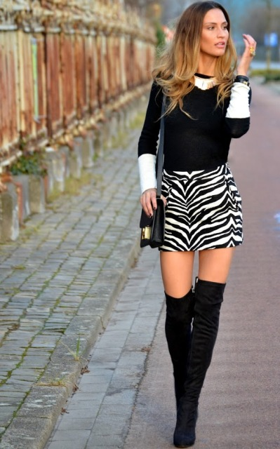 With black and white shirt, black over the knee boots and leather bag