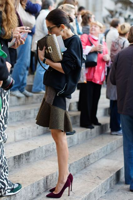 With black loose sweatshirt, marsala pumps and leather clutch