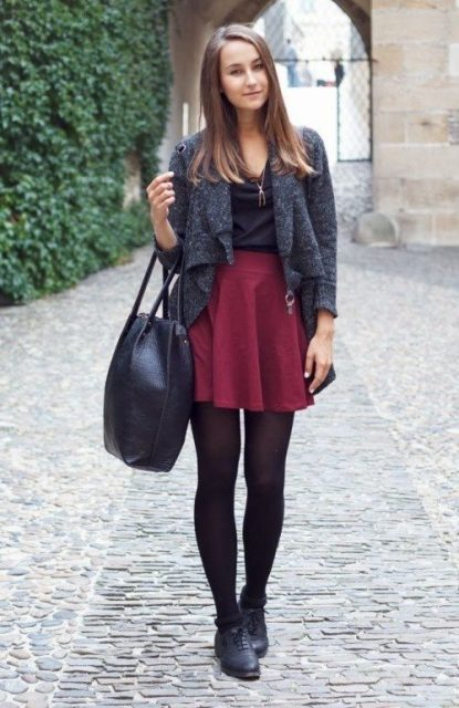 With black shirt, gray cardigan, black tote and black flat boots