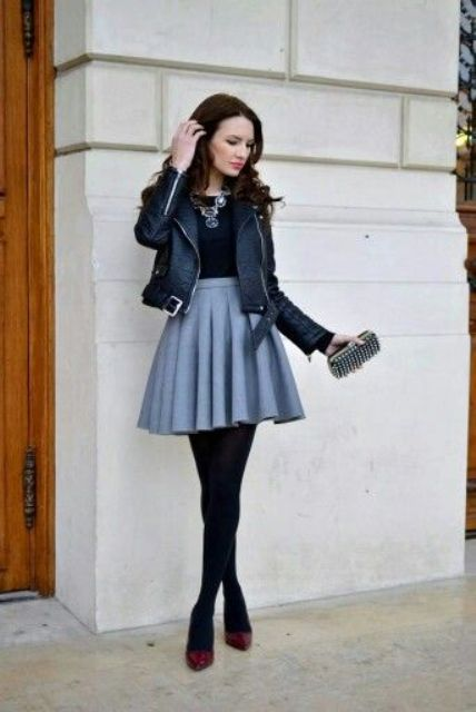With black shirt, leather jacket, high heels and mini clutch