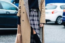 With black shirt, midi coat, fur bag and boots