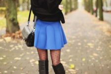 With black sweater, black leather bag, polka dot tights and black high boots