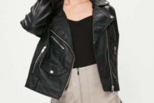 With black top and leather jacket