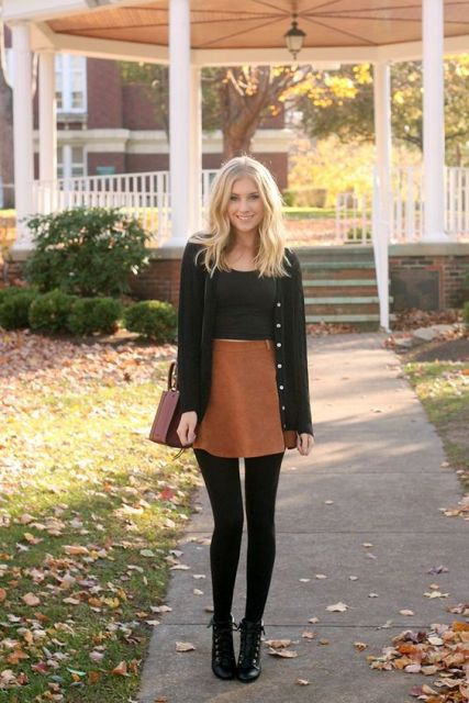 With black top, black cardigan, brown bag and lace up boots
