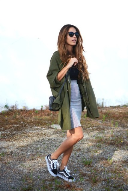With black top, white and black sneakers, black crossbody bag and olive green long shirt