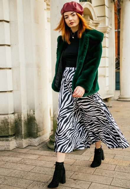 With black turtleneck, beret, green fur coat and black ankle boots