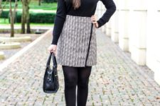 With black turtleneck, black tights, black leather bag and high heels