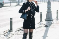 With blouse, red beret, small bag and leather over the knee boots