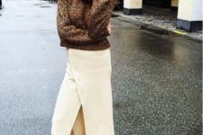With brown sweater and flat shoes