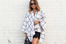 With checked cardigan, leather bag and cutout boots