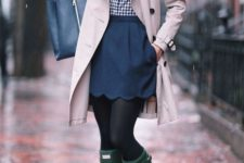 With checked shirt, beige trench coat, navy blue tote and green high boots