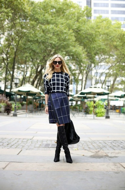 With checked shirt, black tote and black high boots