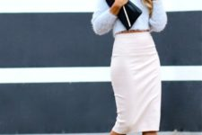 With crop sweater, black clutch and high heels