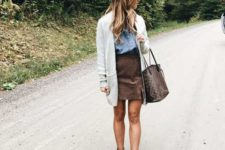 With denim shirt, white cardigan, ankle boots and printed tote