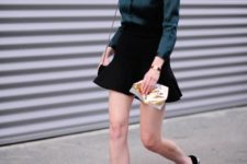 With emerald blouse, flat shoes and chain strap bag