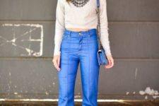 With flare jeans, necklace, chain strap bag and boots