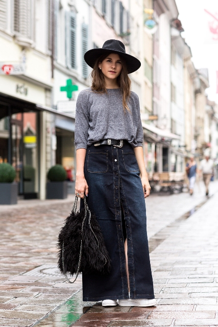 With gray loose shirt, wide brim hat, white sneakers and fur bag