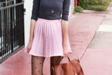 With gray shirt, brown bag and brown leather ankle boots