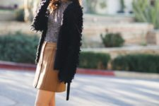 With gray shirt, fur jacket and ankle boots