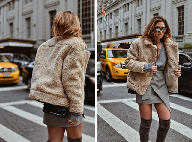 With gray shirt, mini coat and over the knee boots