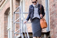 With gray sweater, black leather jacket, brown bag and sneakers