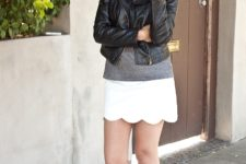 With gray t-shirt, leather jacket and black suede cutout boots