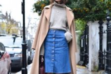 With gray turtleneck sweater, camel coat and pumps