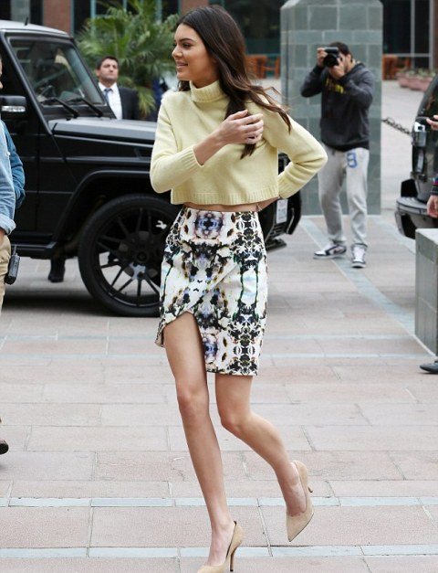 With light yellow crop sweater and beige pumps