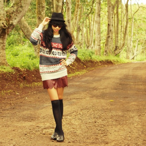 With long sweater, black hat, flat shoes and socks