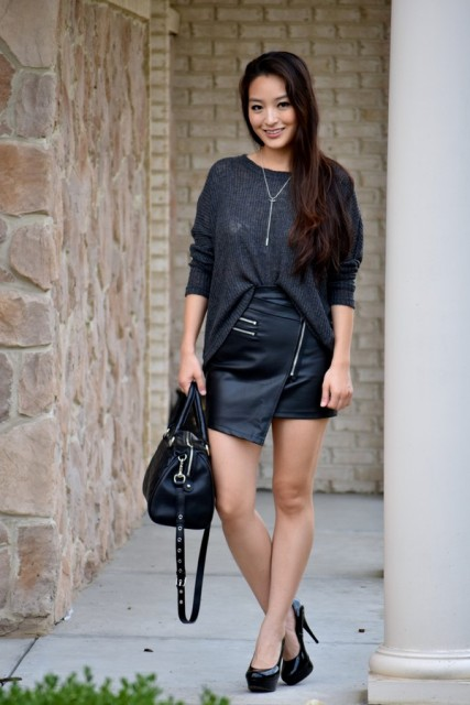 With loose shirt, black pumps and black leather bag