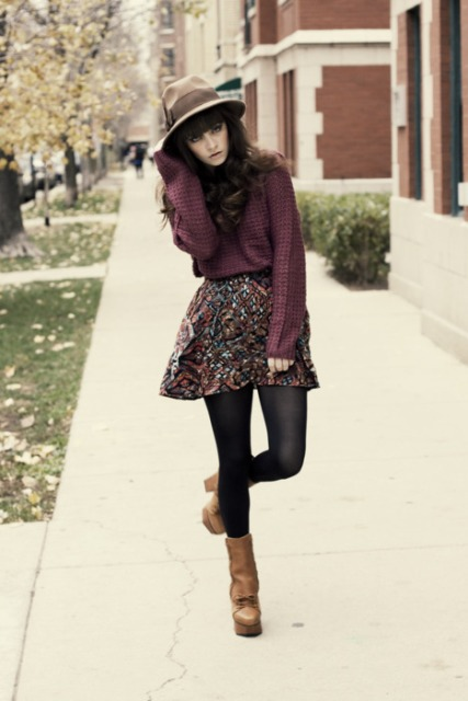 With loose shirt, hat and brown platform boots