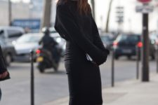 With loose sweater and black cutout ankle boots